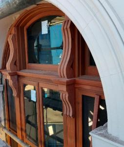 Custom timber window with decorative scrolls