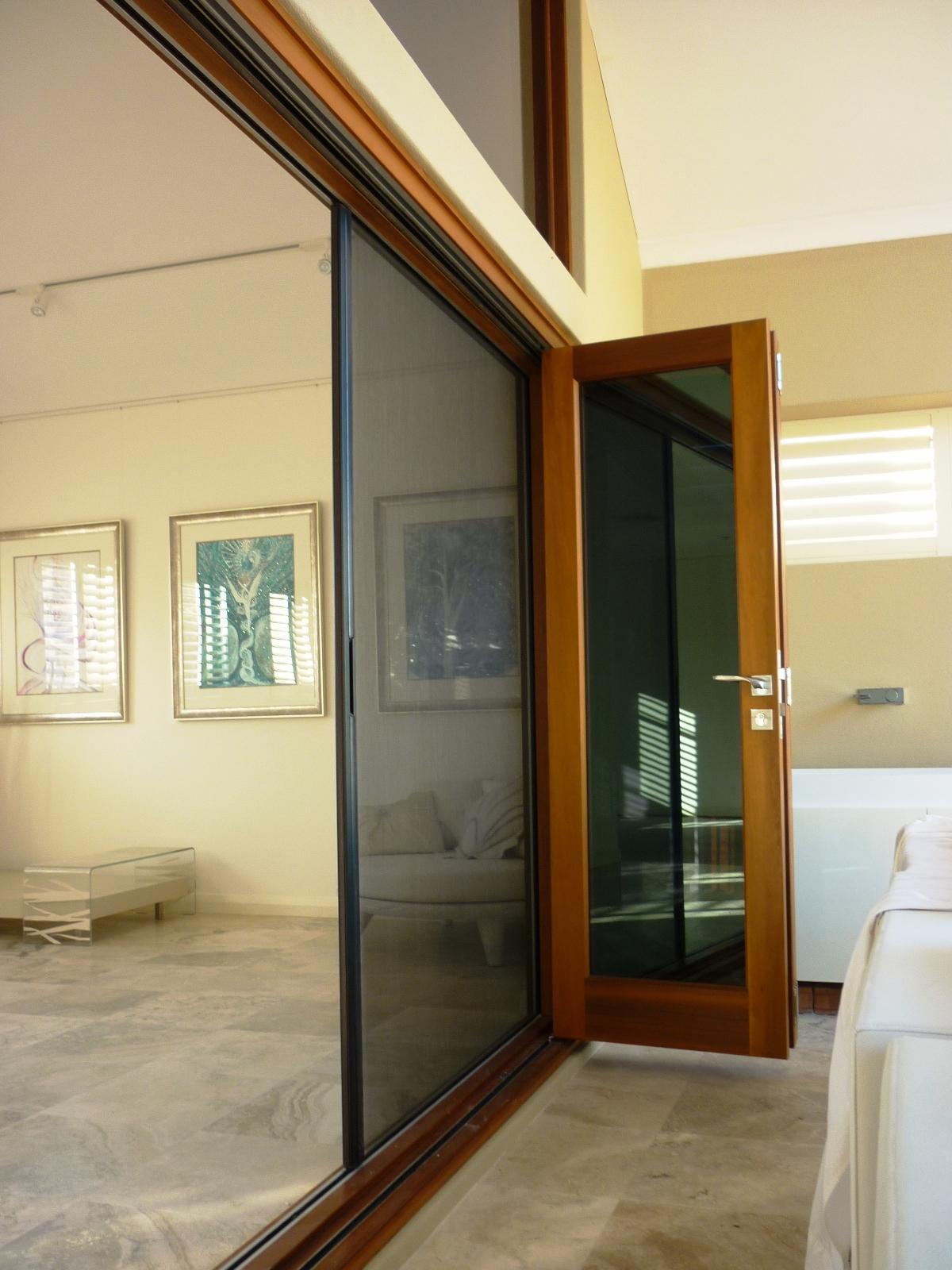 Bifold door with retractable screen